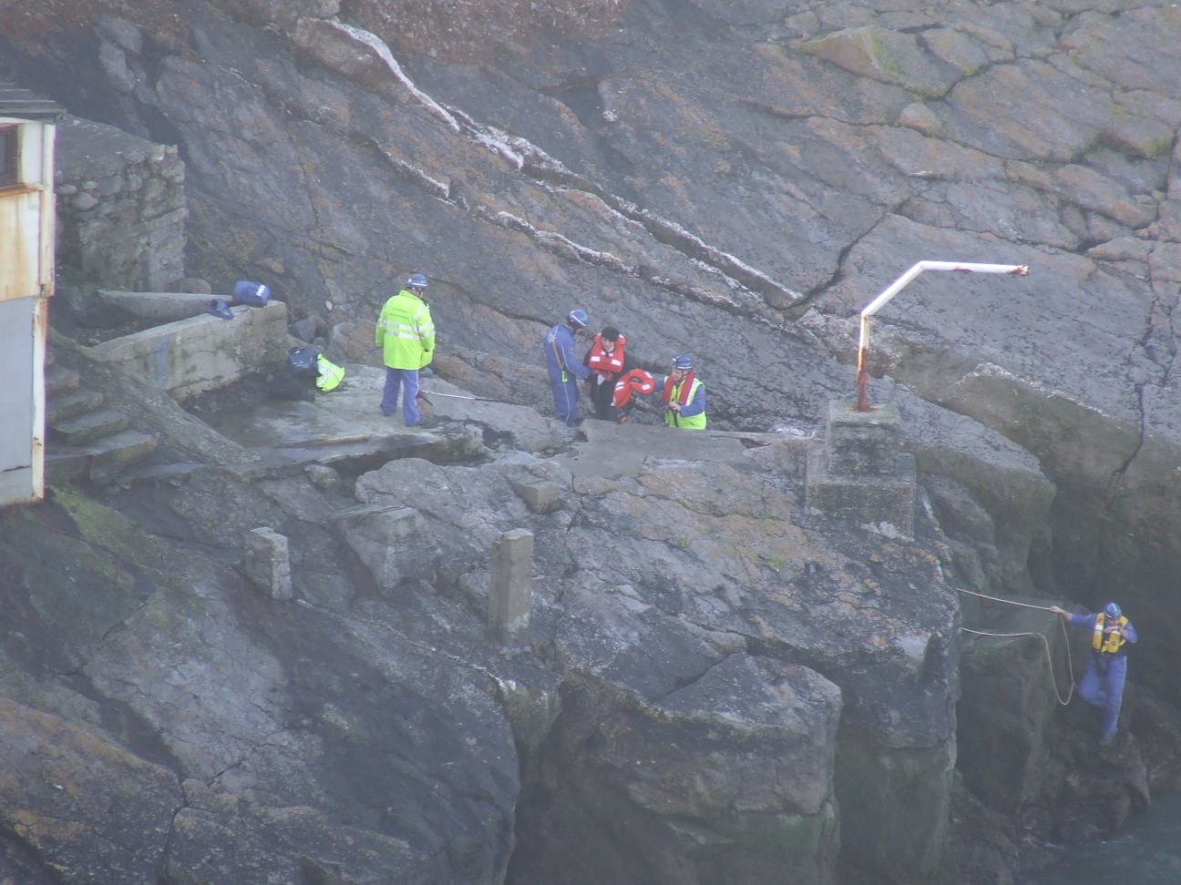 Coastguard_Rescue_Team_assisting_the_men_up_the_cliff